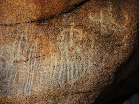 Inside a shallow cave are deeply carved petroglyphs in Baja.